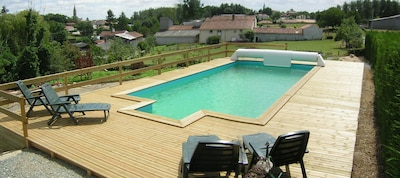 Elevated pool with views to the farmhouse beyond (300m past the sheep)