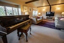 Main TV Lounge with Baby Grand Piano