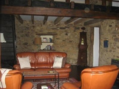 Living room, with mezzanine above