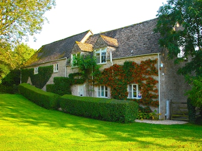 4* Cotswold stone cottage on the banks of the River Thames.