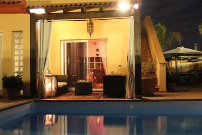 In the evening enjoy sitting on the terrace by the pool.