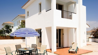 The villa in Pervolia - leading out to the concreted patio and pool.