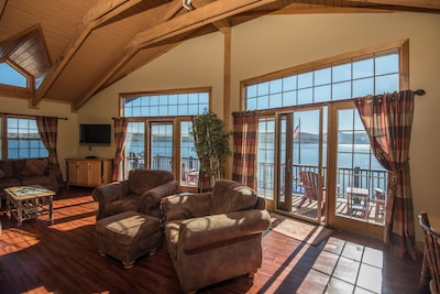 Living room with panoramic views of the lake!