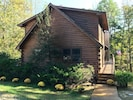Log Home on the lake with two fireplaces,  flagstone patio w/fire pit, hot tub!
