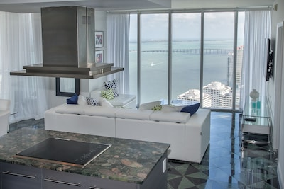Living Room. Sofa looking at the Biscayne Bay. Stunning views!!Floor designed by