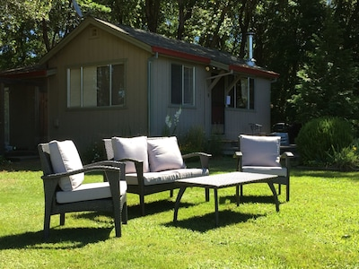 Outdoor lounge chairs on the lawn.