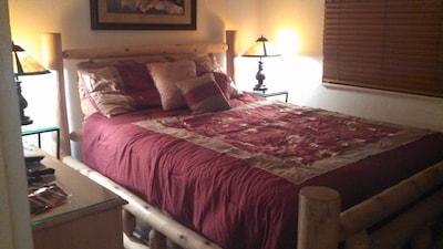 Pillow top queen bed in master bedroom.