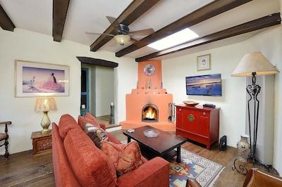 Living Room with Kiva wood burning fireplace