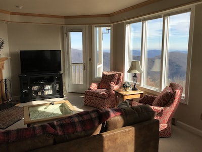 """The living room provides a great view of the mountains, plus a 55"""" HDTV."""