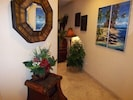 Colorful artwork, Hawaiiana, and elegant tile greet you in the entryway
