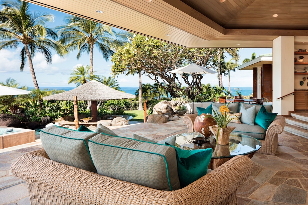 Inviting couches on the Lanai of this home rental in Hawaii