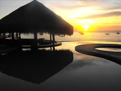 Sunrise through Palapa from My Condo