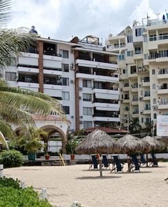 The private beach area in front of the condo building
