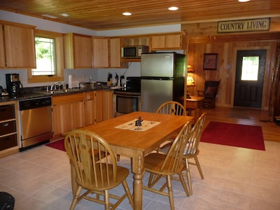 The full service, eat-in kitchen, stocked with utensils and cooking tools.