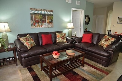 Comfortable living room with  new leather sofa and loveseat.