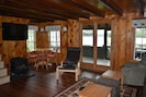 Livingroom, showing game /puzzle table, flat screen TV and Propane heating stove