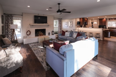 Walk in the front door to an open-concept, living room, dining room, and kitchen