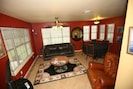 Living Room w/large windows open up spacious views of beautiful 18 acre property