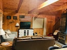 Wood burning stove heats up the entire cabin.