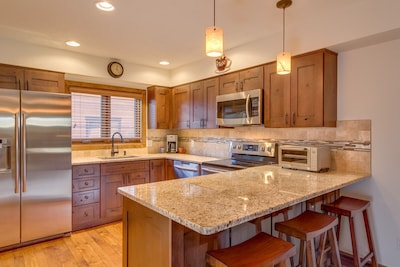 New kitchen with cherry cabinets, granite countertops and stainless appliances