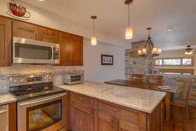 Kitchen opens to dining and family rooms, great for entertaining