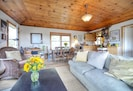 Living Room and Dining Room with knotty pine ceiling.