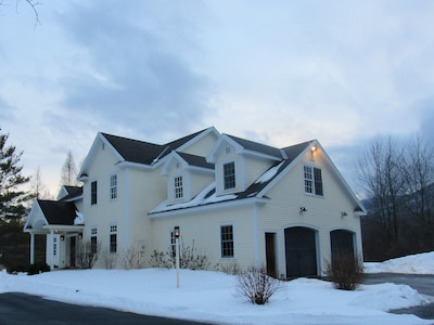 View of the front of the house with ample parking, including heated 2-car garage