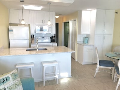 Newly renovated kitchen with lots of storage and hidden trash can.