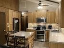 Fully stocked kitchen with double oven range, microwave, dishwasher & fridge
