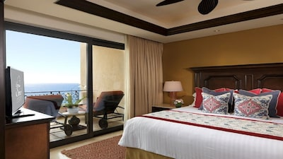 Spacious master bedroom with ocean view and balcony