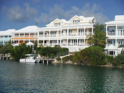 NiceVilla is the right one in the yellow duplex. shared dock. View from marina.