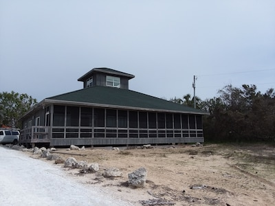 Front of house with screen porch