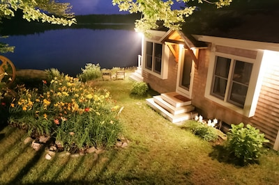 Night view of the cottage with garden.