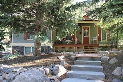 Front of cottage with views of the Continental Divide and Sunrise Peak.
