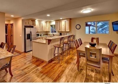 View from front door entering kitchen. Note Costa Rican Walnut hardwood floors.
