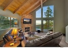 2nd Floor Den: Gas fireplace, rock hearth, mind-numbing  views of Lake Tahoe.