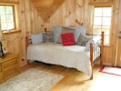 The cozy day bed upstairs is a great space for sleeping or reading a good book.