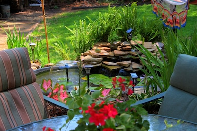 Come relax by the waterfall & fishpond covered with water lilies!