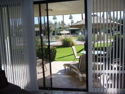 Sun splashed Patio with pool view from the Living Room