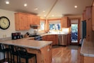 Kitchen with brand new stainless steel appliances.