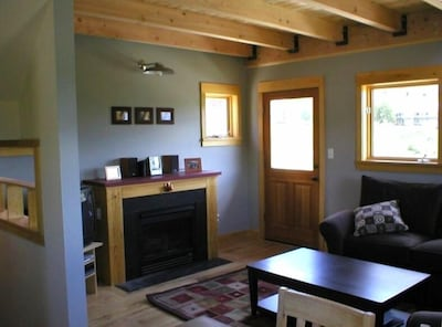 Main floor living area with gas fireplace, outside deck