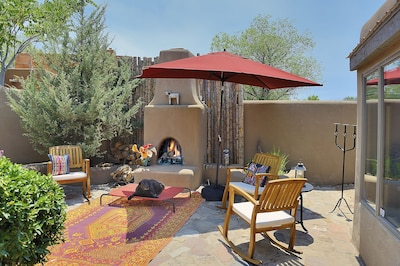 Front Courtyard with Kiva wood burning fireplace