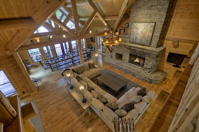 Main Living Room with Wood Burning Fireplace and Dinning Table for 24