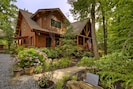 Log home with Beautiful Landscaping