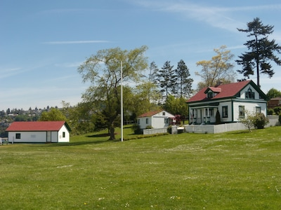 Park grounds, cottage rental on right, History Research Center, and Boat House.