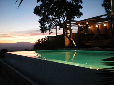 View from pool of sunset over the mountains