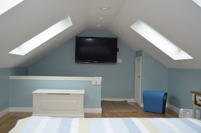 Upstairs loft bedroom, one queen size bed, large screen t.v.