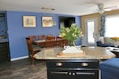 """Kitchen/Dining/Living area, 70"""" TV, dining seats 8"""