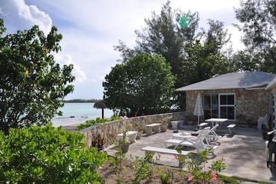 Seaside terrace, beach, and Levy Island across the bay.
