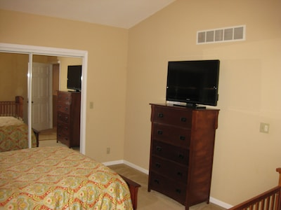 Master Bedroom with Queen size bed, Dresser, and TV with Dish HD